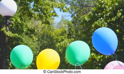 Multi-colored balloons in wind - Multi-colored balloons in...