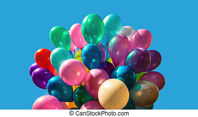 Multi-colored balloons on blue sky background