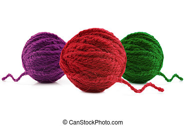 Multi-colored balls of wool on a white background