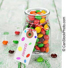 Multi-colored candy on a white table