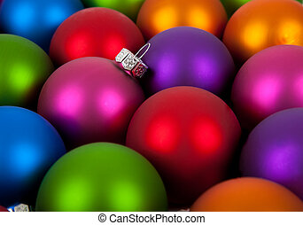 Multi-colored christmas ornament/baubles as a background -...