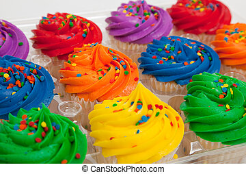 multi-colored cupcakes with sprinkles - Red, orange, yellow,...