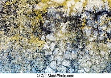 Multi-colored dirt on old concrete wall