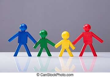 Multi Colored Human Figures Standing In A Row - Multi...