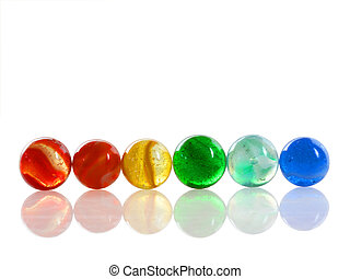 Multi-colored Marbles - Row of 6 colorful antique marbles on...