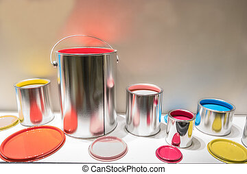 multi colored paint cans, red yellow green blue and pink