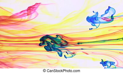Multi colored paints mixed in water. Chaotic motion and...
