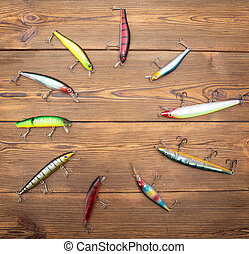 Multi-colored spinners for fishing on a wooden background. Concept place for an inscription, fishing, copy space