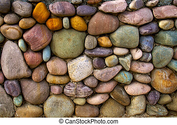 Multi-colored stone wall background - a rock wall that was...