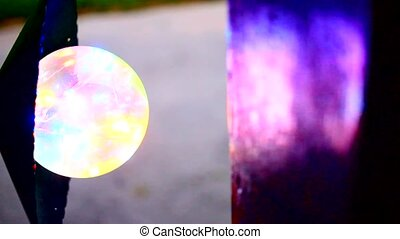 Glow Of a multi-colored street lamp.