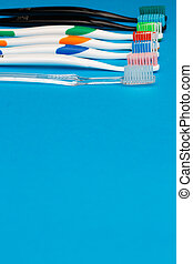 Multi colored toothbrushes on top