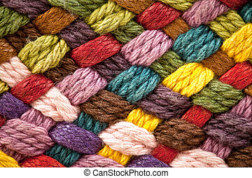 multi colored woollen yarns - image of braided multi colored...
