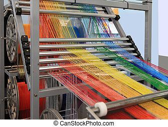 multi-colored yarns in the textile machine - yarn warping...