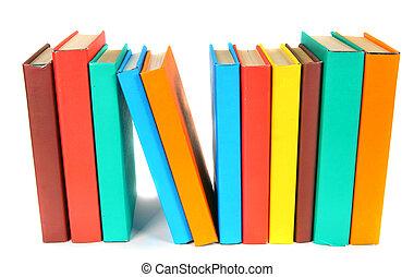Multi-coloured books. On white background. - Multi-coloured...
