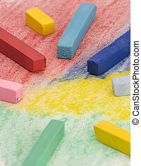 Multi Coloured Chalk sticks on a coloured background.