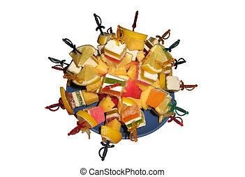 Multi-coloured dessert from fruit