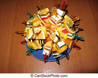 Multi-coloured dessert from fruit candy and a lemon