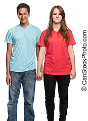 Happy boy and girl holding hands and smiling at camera. Studio shot on white background.