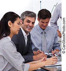 Multi-ethnic business co-workers in a meeting