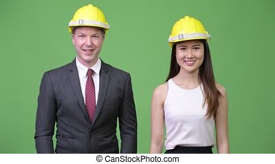 Multi-ethnic business couple as engineers together
