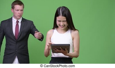 Multi-ethnic business couple together - Studio shot of young...