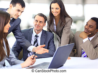 Multi ethnic business executives at a meeting discussing a...