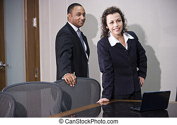 Multi-ethnic business executives standing in boardroom