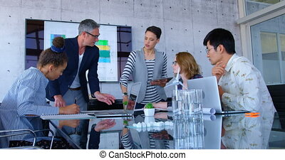 Multi-ethnic business people discussing over blueprint in the conference room at modern office 4 4k