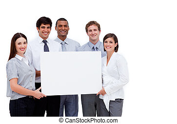Multi-ethnic business people holding a white card against a...