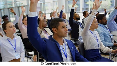 Multi ethnic business people raising hands in the business seminar 4k