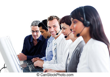 Multi-ethnic business people using headset