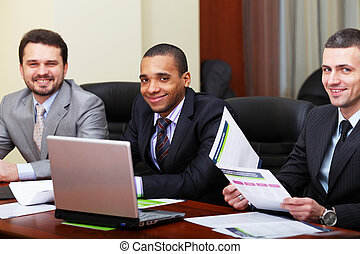 Multi ethnic business team at a meeting. Focus on african-american young man