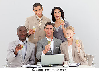 Multi-ethnic business team celebrating a success with champagne