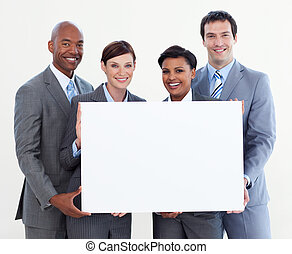 Multi-ethnic business team holding white card isolated on...