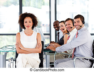 Multi-ethnic business team in a call center