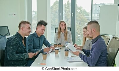 Multi-Ethnic Business Team Meeting - Multi-ethnic business...