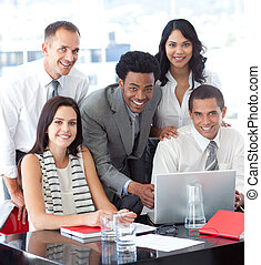 Multi-ethnic business team working together in office -...