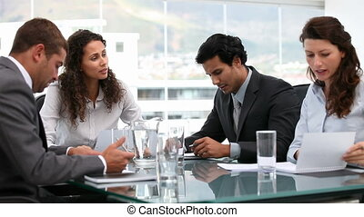 Multi ethnic business team working together during a meeting