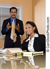 Multi-ethnic businessman and businesswoman working in office