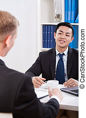 Multi-ethnic businessmen during meeting in office