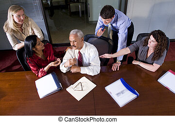 Multi-ethnic businesspeople meeting at table in boardroom