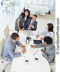 Multi-ethnic businessteam working in a project in a meeting...