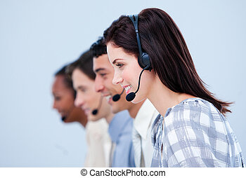 Multi-ethnic customer service representatives in a call...