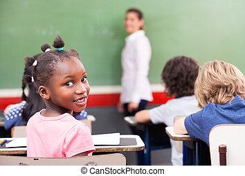Multi ethnic elementary classroom.