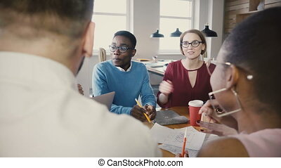 Multi ethnic group at office business meeting. Young diverse...