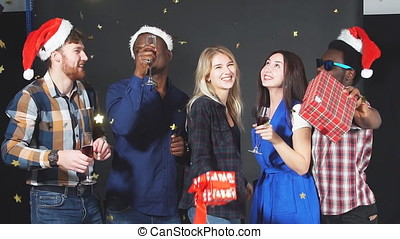 Multi ethnic group friends dancing and having fun at...