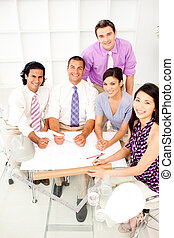 Multi-ethnic group of architects in a meeting