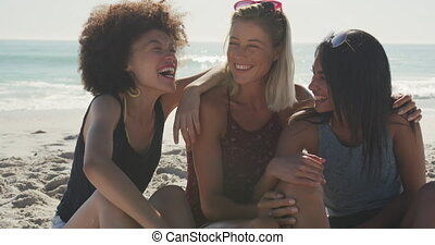 Multi-ethnic group of friends enjoying time in the sun - ...