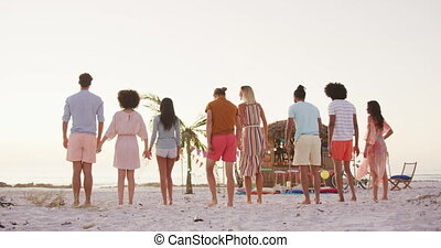Multi-ethnic group of friends on holiday enjoying time ...