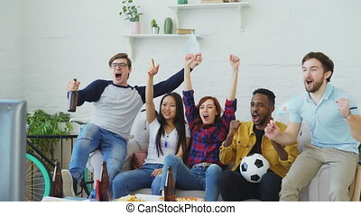 Multi-ethnic group of friends sports fans with Argentinian...